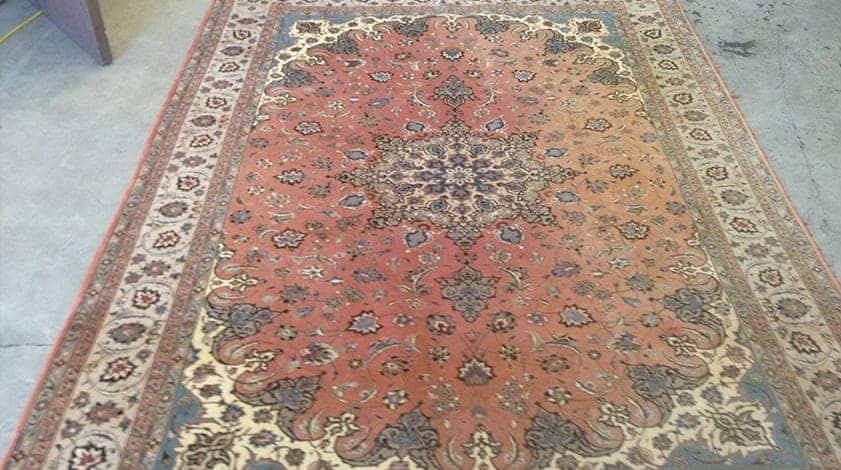 Rug suffering from sun damage